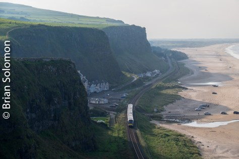 Using my 18-135 zoom, I've remained at the same cliff-side vantage point, but pulled back the focal length. Here the NI Railways 4001-series railcar is more prominent.