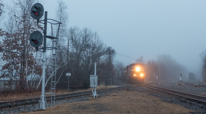 Fog over Palmer; CSX Intermodal crosses the New England Central.