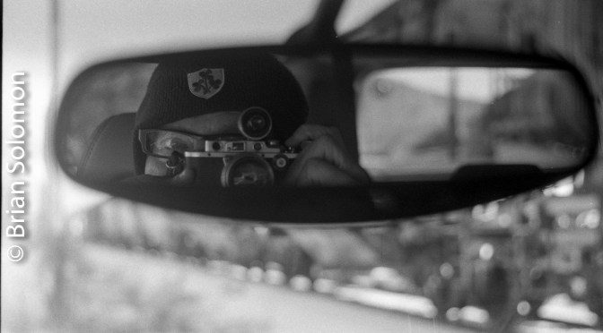 Self-portrait using the rear view mirror.