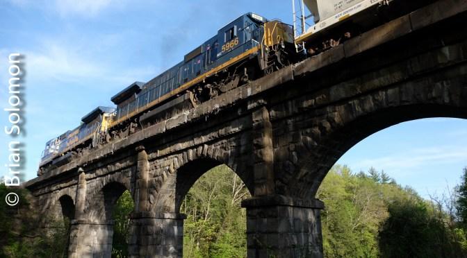 Pan Am Railway's EDBF: Stone Arches and DASH8s.