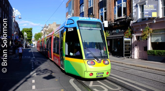 Sunny Saturday: Colourful Tram Works LUAS Green Line on Dawson Street—3 photos.