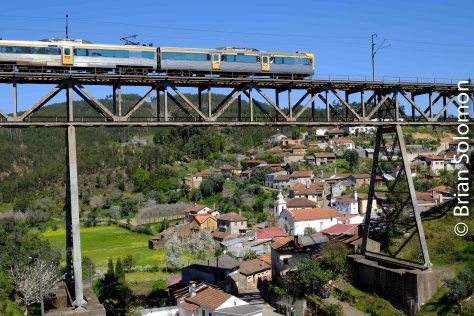 Deep in a valley, far from main roads, Portuguese Railways' Beira Alta line soars across the village of Trezoi.