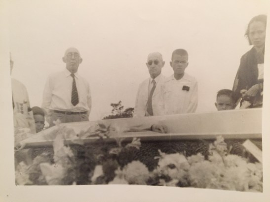 My grandfather's funeral. At far right is my grandmother with my dad peering over the coffin. August 1950.