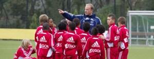 Kids receive instructions from former Dutch international Dennis Bergkamp at an Ajax Talent Camp