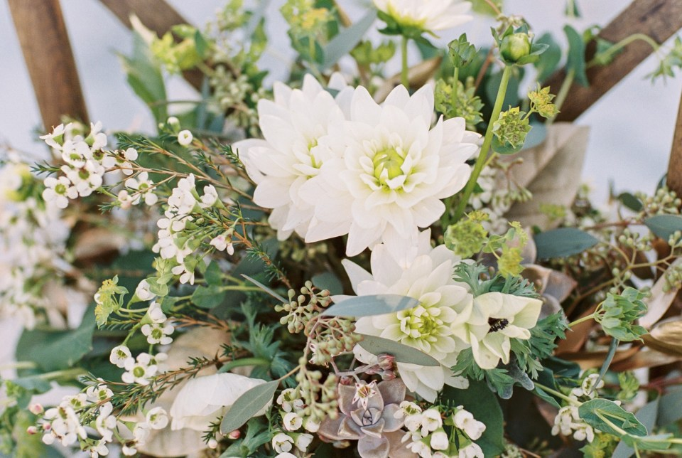 Greenery bouquet with white dahlias and gold accents | Mermaid Inspired Beside the Sea Wedding Shoot | www.bricibene.com