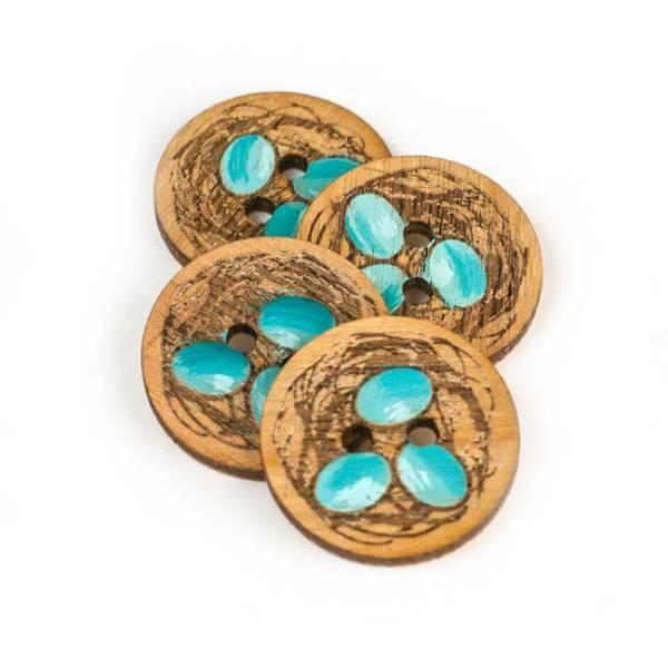 Eggs in nest – button