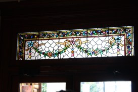The transom above the front door is leaded glass representing garlands of flowers and leaves