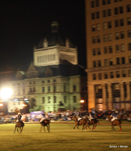 "Lexington's historic courthouse and first ""sky scraper"" loom over the players."