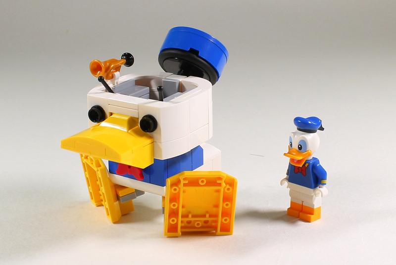 It's a Mecha Face-Off With The Custom LEGO Mecha Donald Robo!