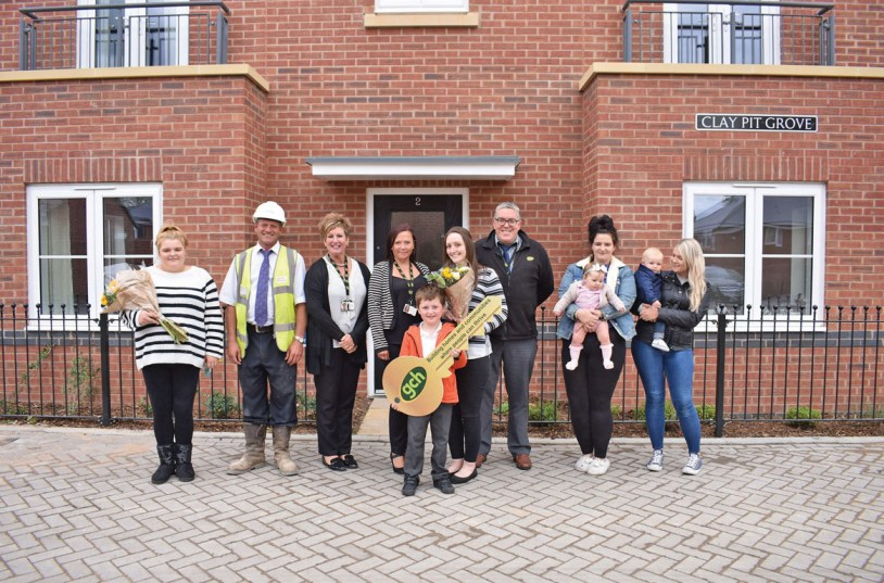 GCH residents outside their new homes