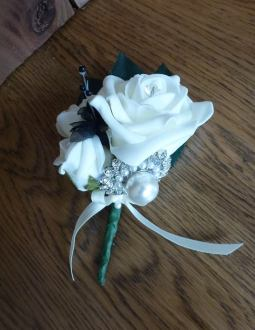 Black and white pearl brooch buttonhole