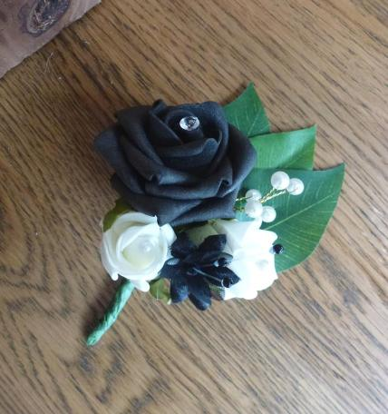 Black and white pearl wedding buttonhole