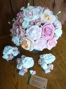 Pink and peach bouquet with pearl peach wrist corsages