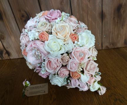 Pink and peach fake flowers bridal bouquet waterfall