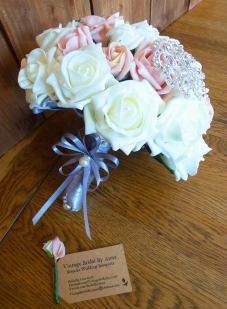 Silver handle on pink brooch bouquet