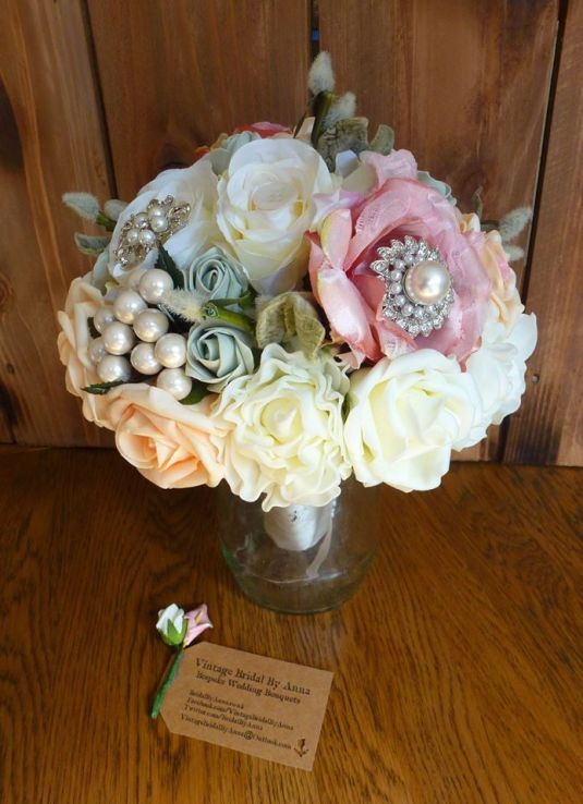 Vintage brooch and pearl silk wedding bouquet