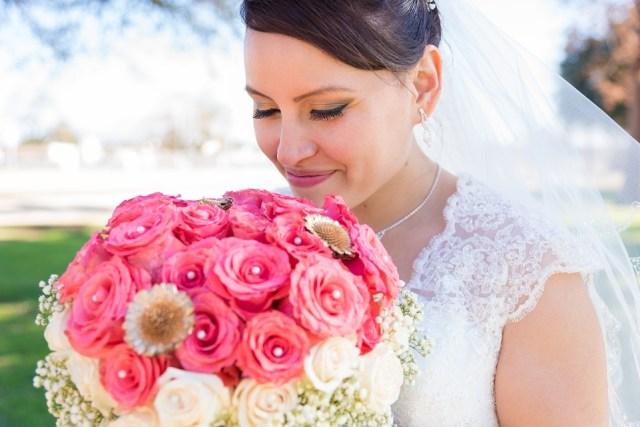 bride smelling flower arrangement