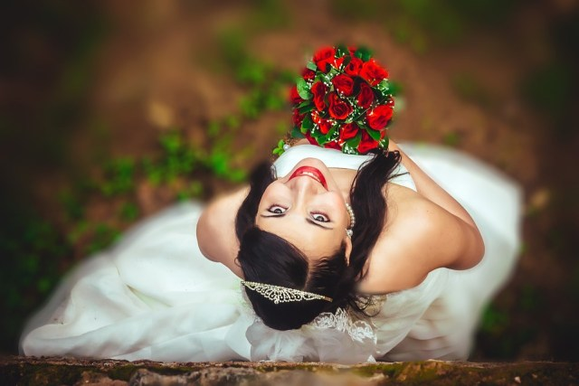 Looking up smiling wedding red roses