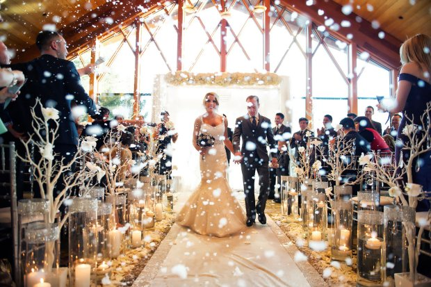 Winter Weddings Wedding Snow Confetti Bride and Groom Walk Down the Aisle Say I Do
