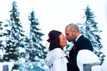 snowy wedding kiss
