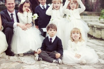children pulling funny faces at wedding