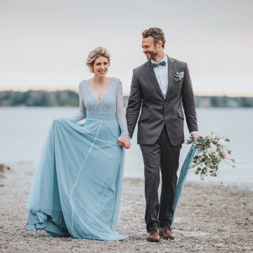 Stormy Scandinavian Wedding Inspiration Featuring a Dramatic Blue Gown | Snowflake Photo 1