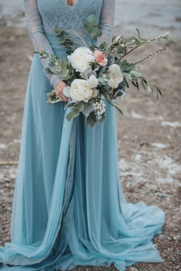 Stormy Scandinavian Wedding Inspiration Featuring a Dramatic Blue Gown | Snowflake Photo 29