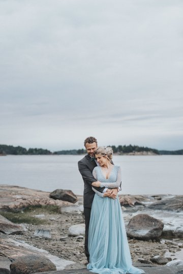 Stormy Scandinavian Wedding Inspiration Featuring a Dramatic Blue Gown | Snowflake Photo 38