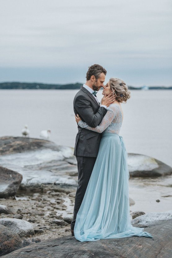 Stormy Scandinavian Wedding Inspiration Featuring a Dramatic Blue Gown | Snowflake Photo 41