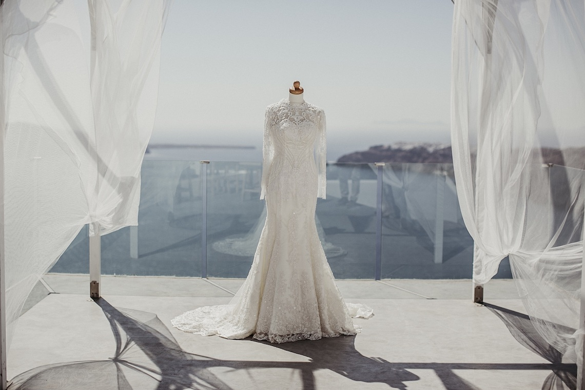 Intimate & Luxurious Cliffside Santorini Wedding | Stella and Moscha | Nikos Gogas 36