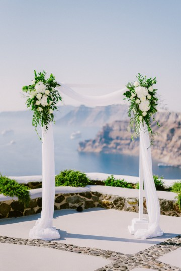 Classy Santorini Destination Wedding (With Amazing Caldera Views!) | Elias Kordelakos 11