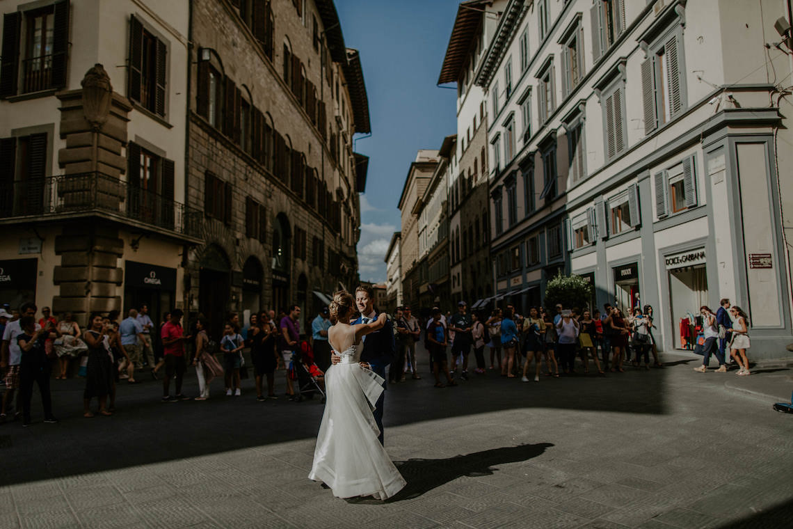Bride and Groom Dancing in the Piazza in Florence Italy