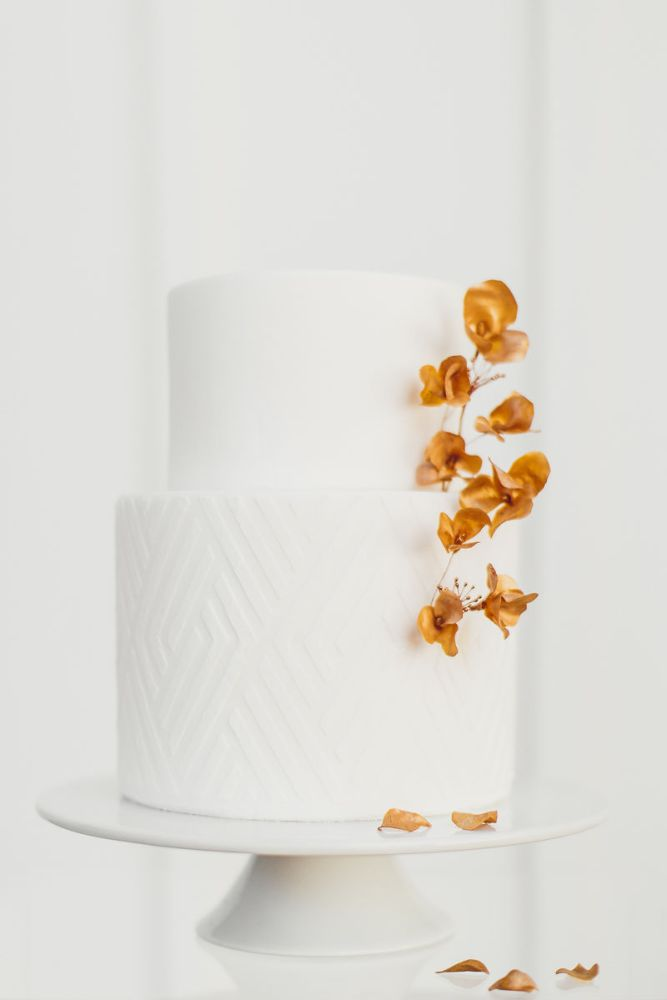 Minimalistic White Wedding Cake with Gold Florals