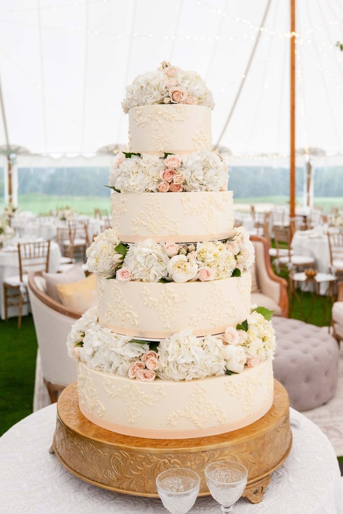White & Pink Lace Wedding Cake with Layers of Florals