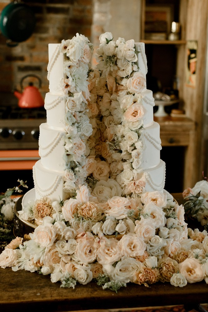 'Cut Open' Wedding Cake with Cascading Flowers