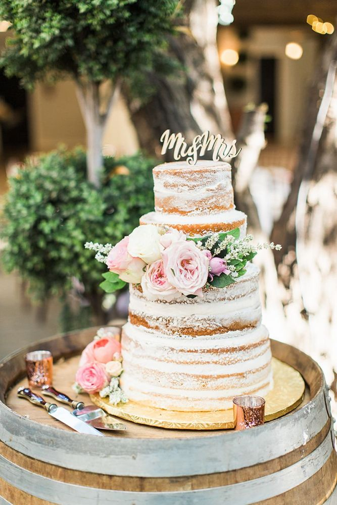 Towering Naked Cake with A Wooden 'Mr & Mrs' Cake Topper
