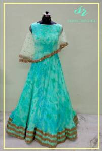 Cape, crop top, lehenga, maggam work blouse designs by Sravani Rao