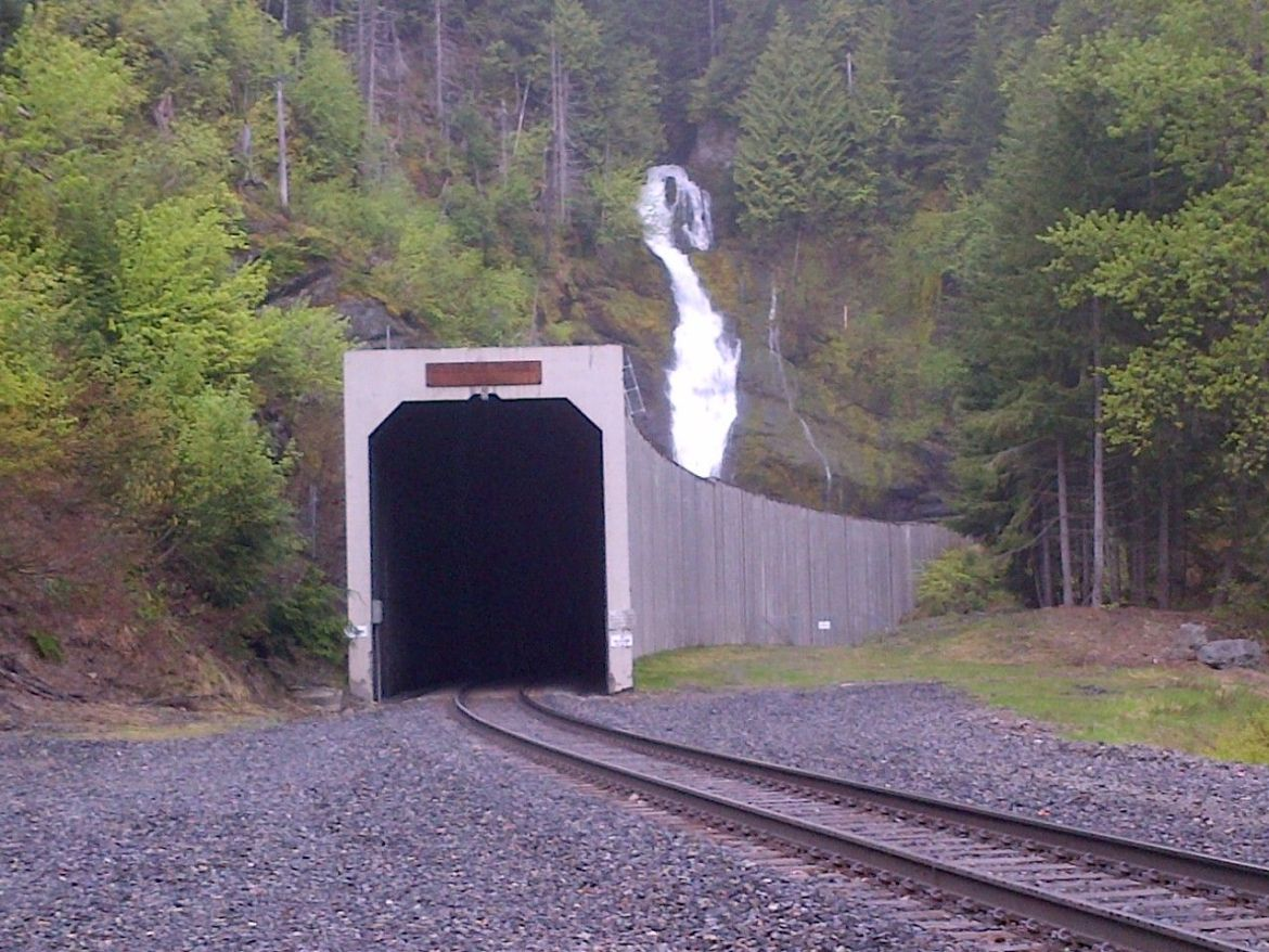 East Portal of the Stampede Pass Railroad tunnel as the tunnel snakes back towards the encroaching mountains