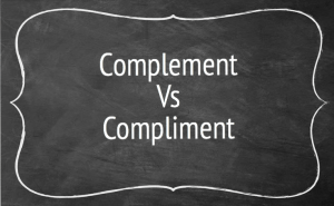 A chalkboard reading complement vs compliment