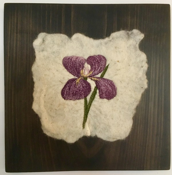 Purple Iris threadpainted on felted fabric mounted in wood