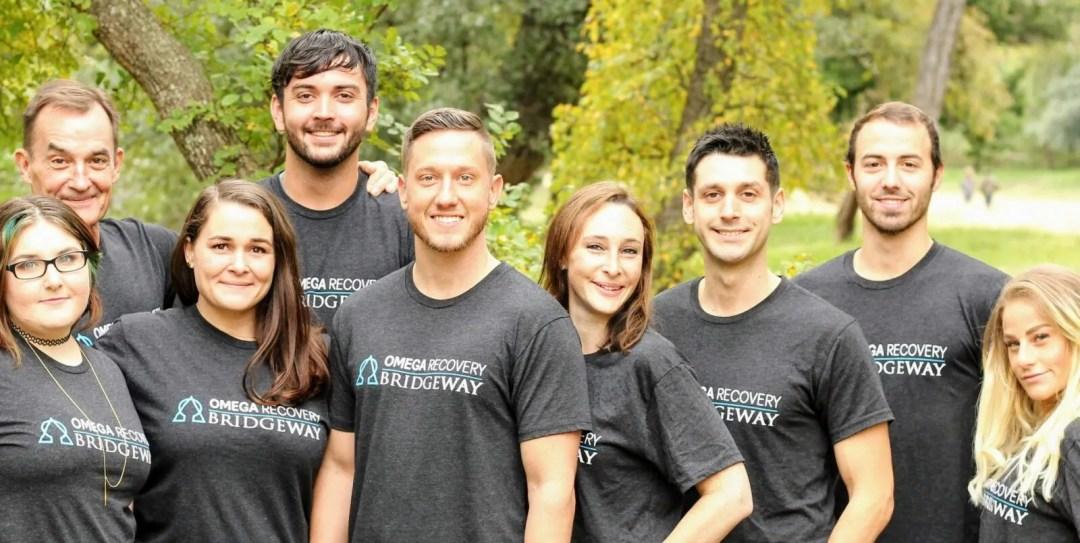 Group indoor photo of the team in Bridgeway t-shirts
