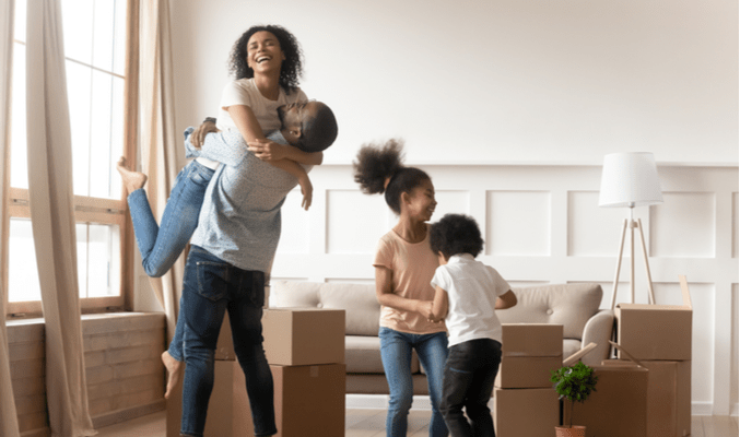 Happy family move into a property