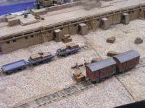 Two of the objectives for the squads - flat railway cars and covered wagons