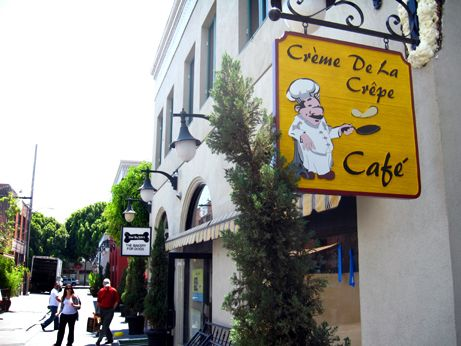 Creme De La Crepe Cafe has up their signage and is actively building out their space