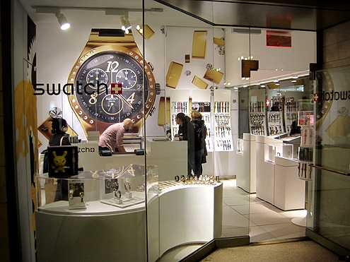 Small shops like this Swatch store line the corridors