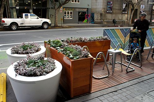 New landscaping and street furniture improve the aesthetics along Spring Street