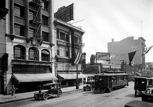 An historic photo circa 1920 shows the lower facade of the L.L. Western Costume Company (on the left)