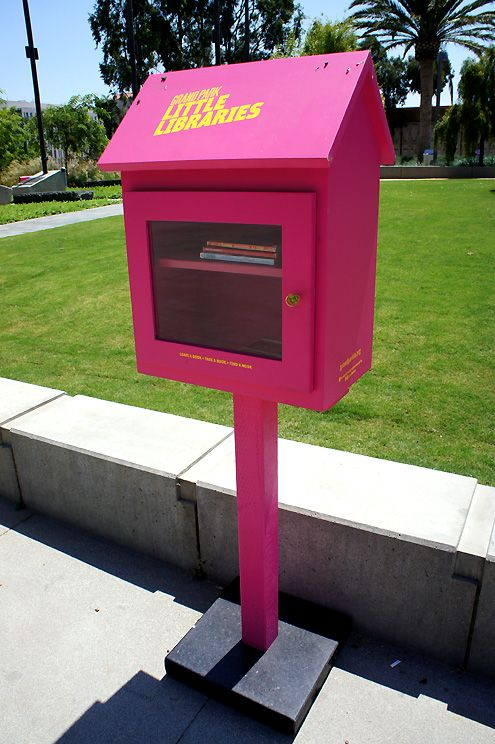 A total of four of these hot fuschia pink library stands are placed in each section of Grand Park