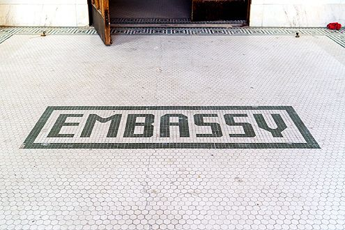 The former Embassy Hotel mosaic floor tiling greets the front entrance along Grand Ave