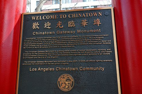 Welcome to Chinatown plaque sandwiched between the gateway pillars